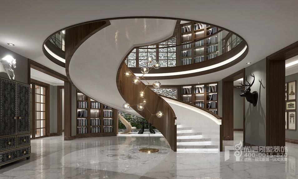 楼梯间可以说是本案最大的亮点所在。在圆形的空间之中,四面八方的通道使得空间更加的开阔,向上的圆形镂空在迎接向上延伸的阶梯的同时像是为空间打开了一个巨大的天井,于是整个空间都变得通透。 别墅室内设计师彭老师利用护墙墙面的空间,视线所及之处陈设的都是书籍,整个空间的深度就在这些书页中累积加深,上下两层楼相呼应,通过巨大的圆形形成倒影,成就了这般玄之又玄的空间镜像效果。 联排别墅装修设计楼梯的弧度同样是这一空间的精彩所在,如何在装修之中将楼梯向上延伸的弧度打造的如此完美,实在是考验施工人员的手艺了。